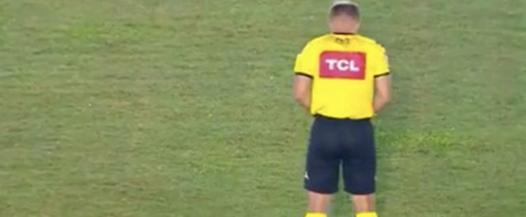 BIZZARE: Referee Caught Urinating On The Pitch Before Kick-off